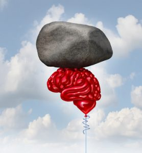 Brain power concept as a red balloon shaped as a human thinking organ lifting up a heavy rock as a symbol and mental health metaphor for powerful creatve intelligence and memory.